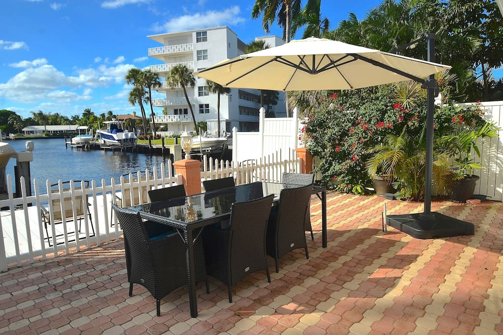 Private Rear Waterfront Lounge Features Three (3) Dining Tables + Sofa Lounge + Spectacular Views...