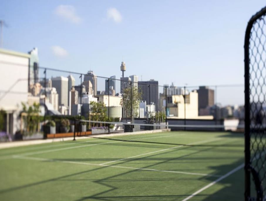 Rooftop Tennis Court with city views.