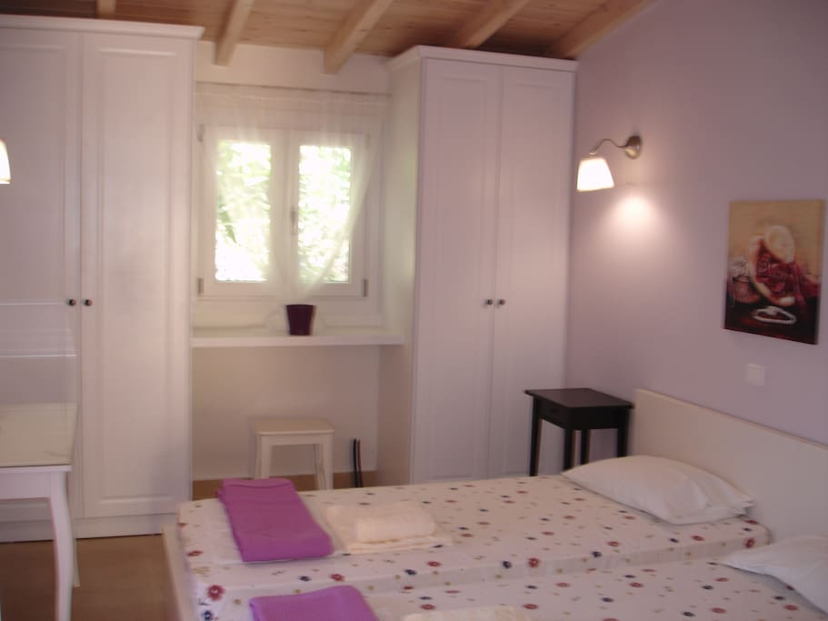 Lilac bedroom with 2 single beds