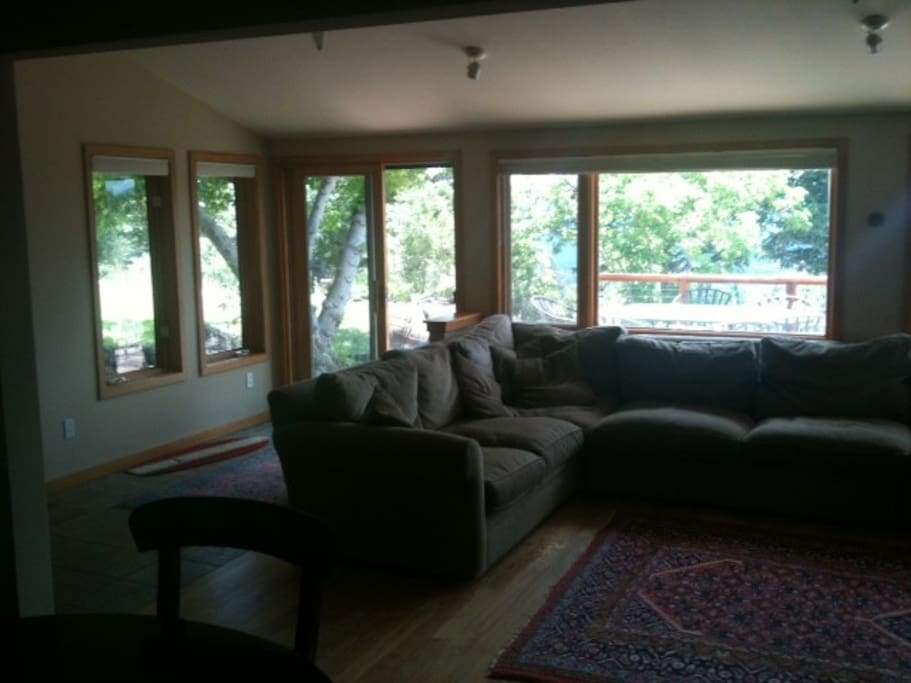 Living room out to deck and front yard