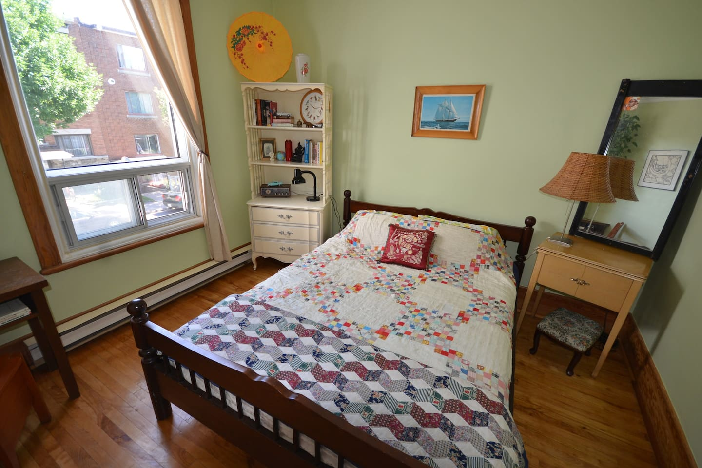 the guest room: sunny master bedroom for 2 with dresser, closet and desk.