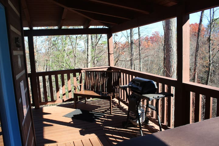 side porch with hot tub off living room