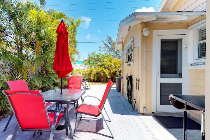 Sunny, dog-friendly cottage w/ a spacious patio and grill, steps from the beach!