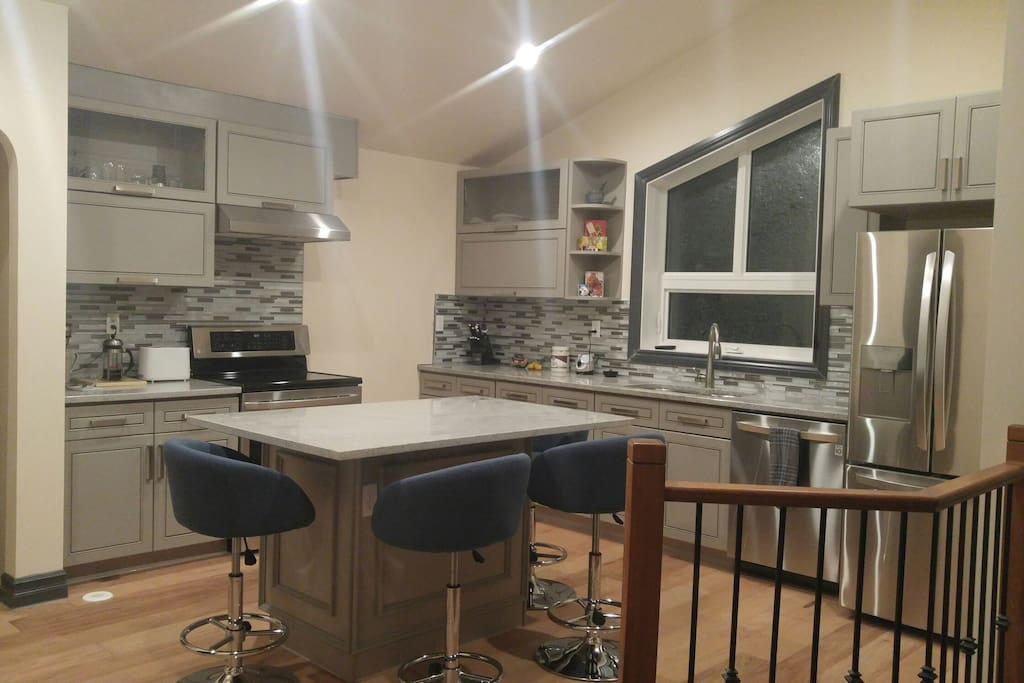 Kitchen with six chairs and dishwasher
