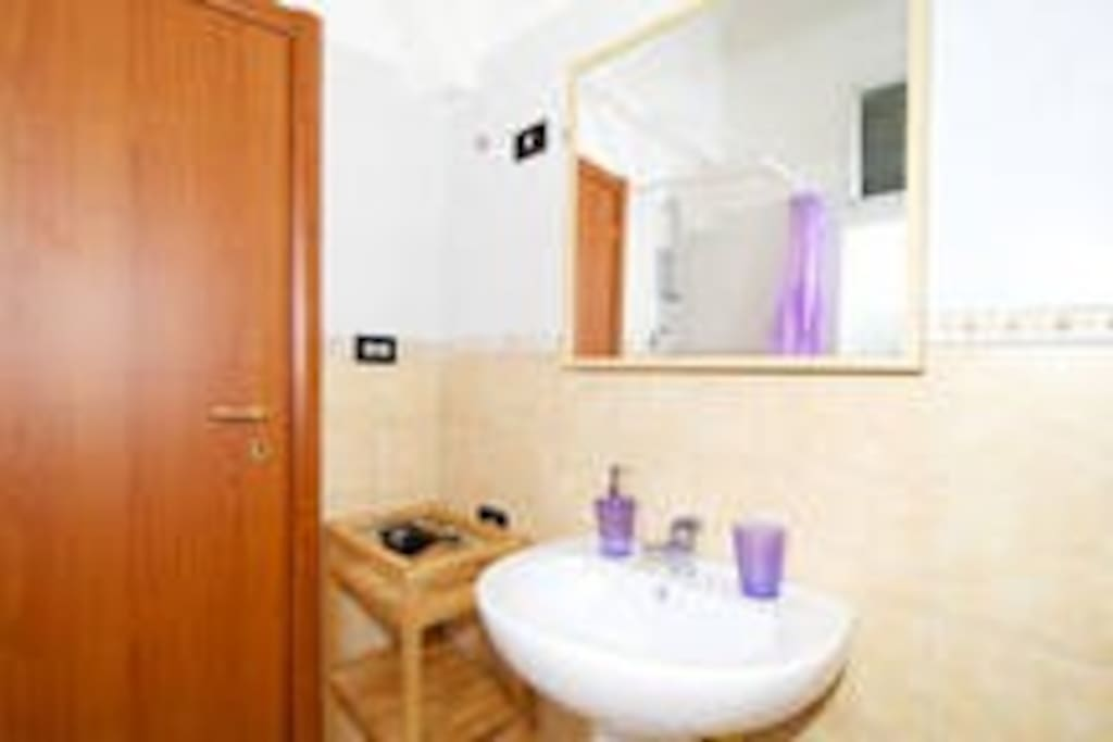 bathroom with shower, bidet, toilet, faucet, washing machine