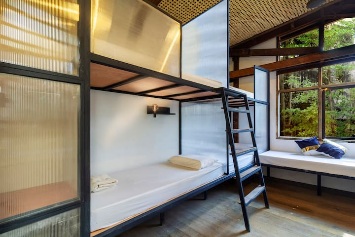 Clean & comfy bed in 10-bed dorm with pool access