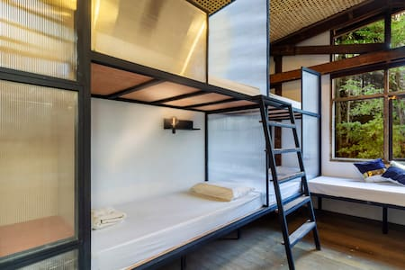 Comfy bed in 10-bed mixed dorm with air condition, private locker, private reading lamp, FREE Wifi and USB sockets