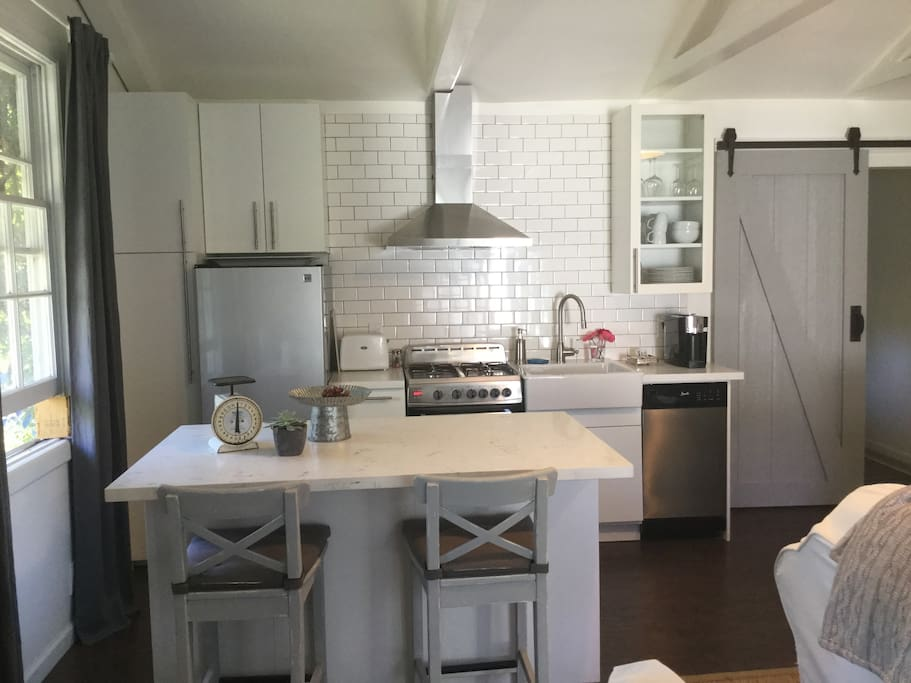 Stainless fridge, microwave, stove and dishwasher, plus all the plates, cups, utensils and pots to make whatever you want! Plus Starbucks pod coffee maker!