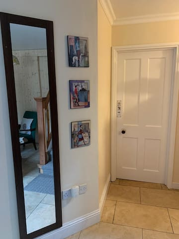From the entrance area you have access to your room, you access also a small hallway leading to our  kitchen/living room and you have access to stairs leading to our bedrooms.