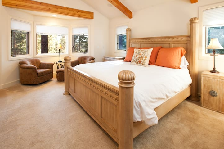 Bright and spacious grand master suite with views, en suite bathroom, walk-in closet, and laundry shoot. Located on the main floor.
