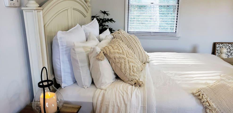 Queen Bed with pillow mattress topper.