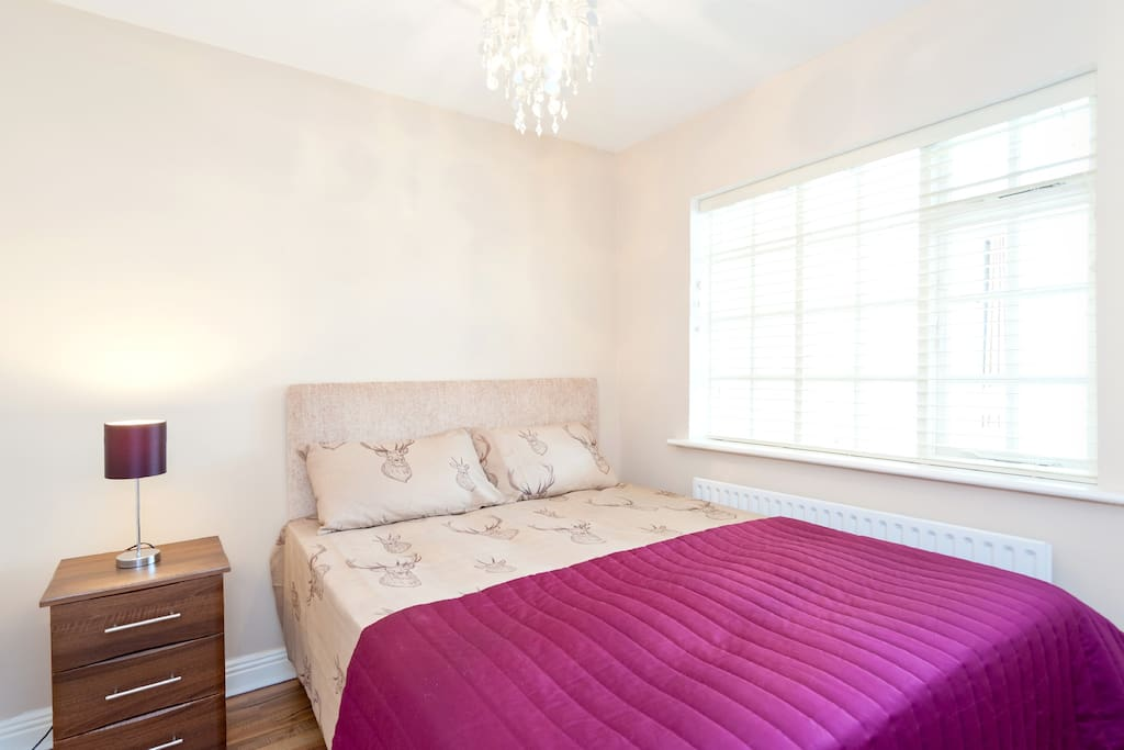 King size bed with wall-mounted headboard and orthopaedic mattress!