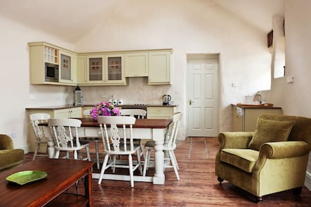 One of two adjoining 19th-century cottages (rent 1 or both), this characterful coach house has been beautifully renovated to provide every modern convenience and comfort, with 3 en-suite bedrooms and a fold-out sofa in the largest one.