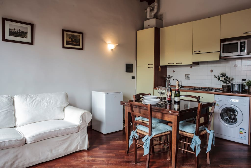 Bright dining room with 2 windows, Original Tuscan wooden ceiling, Parquet, TV, WIFI internet, fans, sofabed, table and fully equipped kitchen.