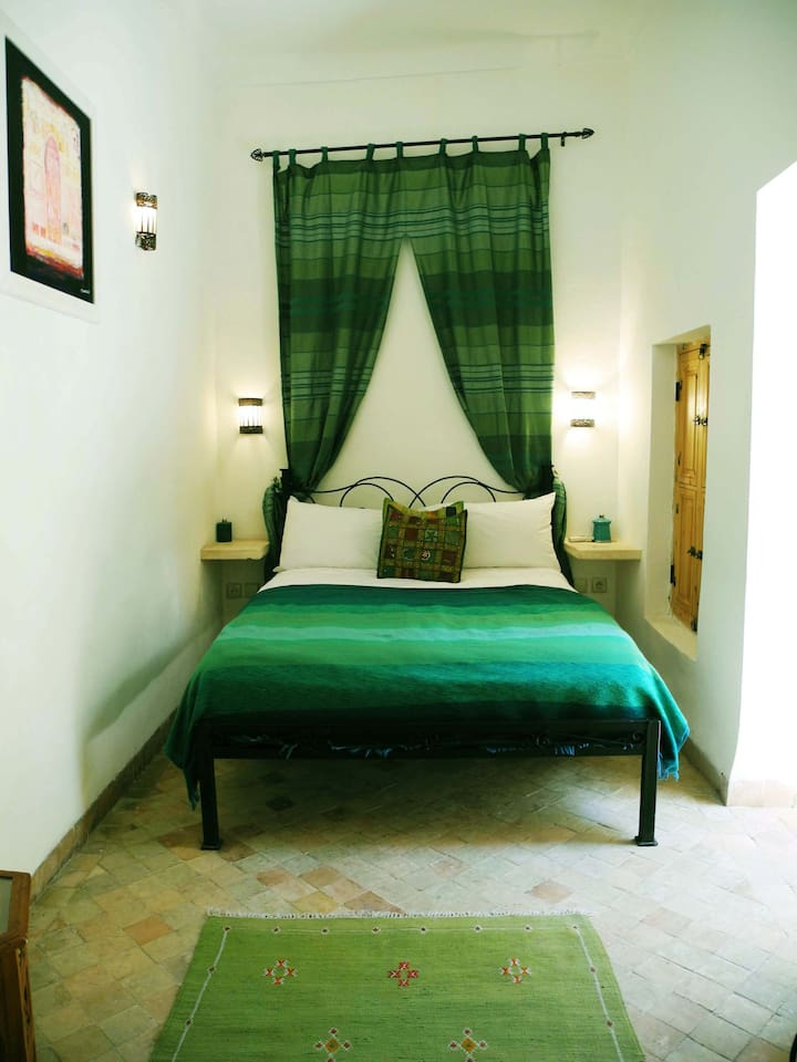 Our cosy Green Double bedroom with en suite tadalect bathroom.