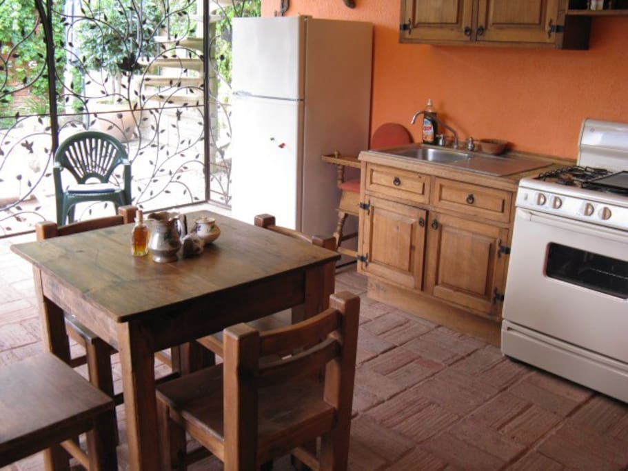 Fully equipped eat-in kitchen opens to patio