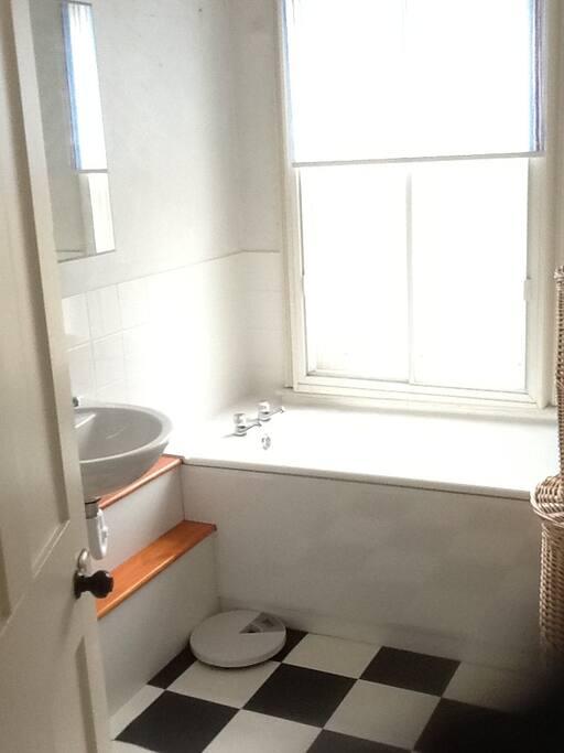The bathroom is next door to your room