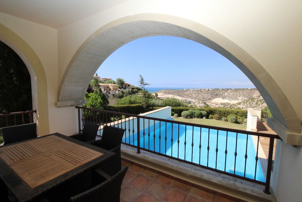 Terrace overlooking pool, sea and mountains
