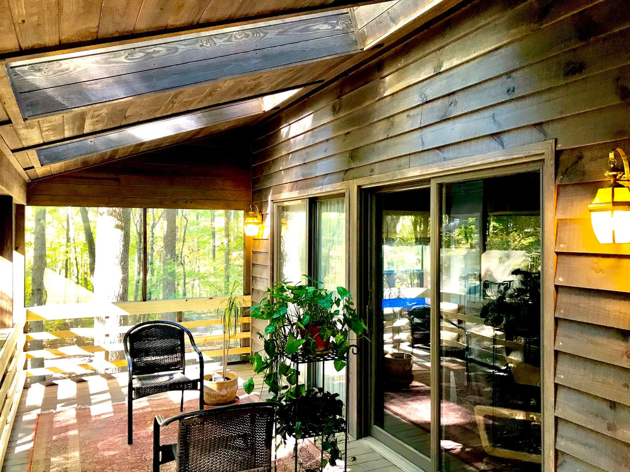 Wraparound porch on south and east sides with large skylights to let in the sunlight.