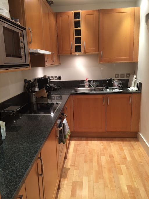 New, modern kitchen with all appliances needed.