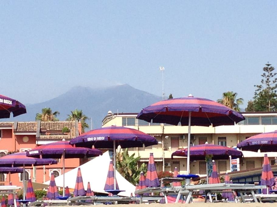 Etna volcano behind the beach