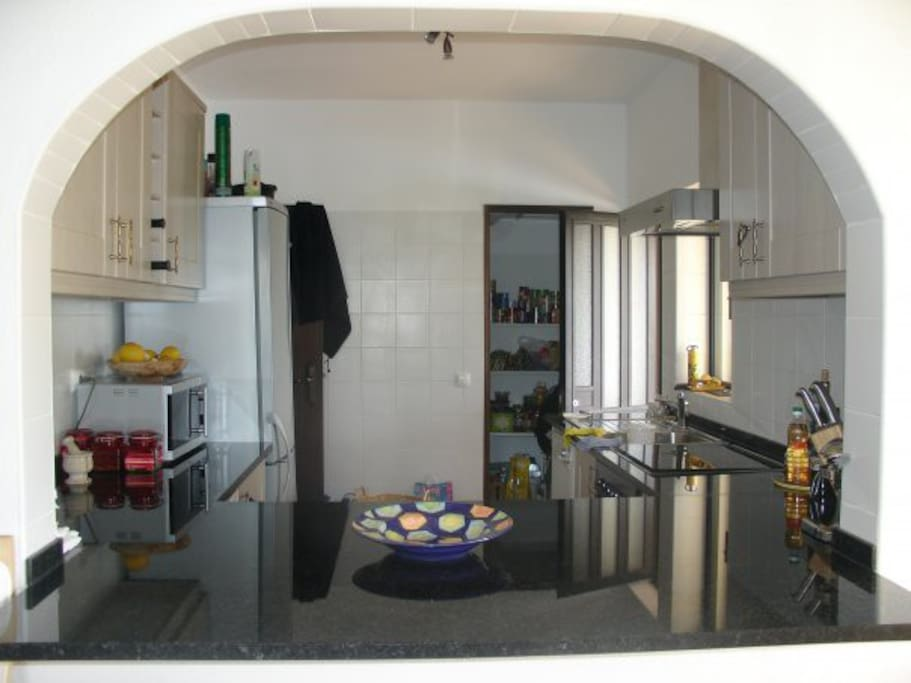 Fully equipped modern kitchen, including gas stove, electric oven, dish washer.