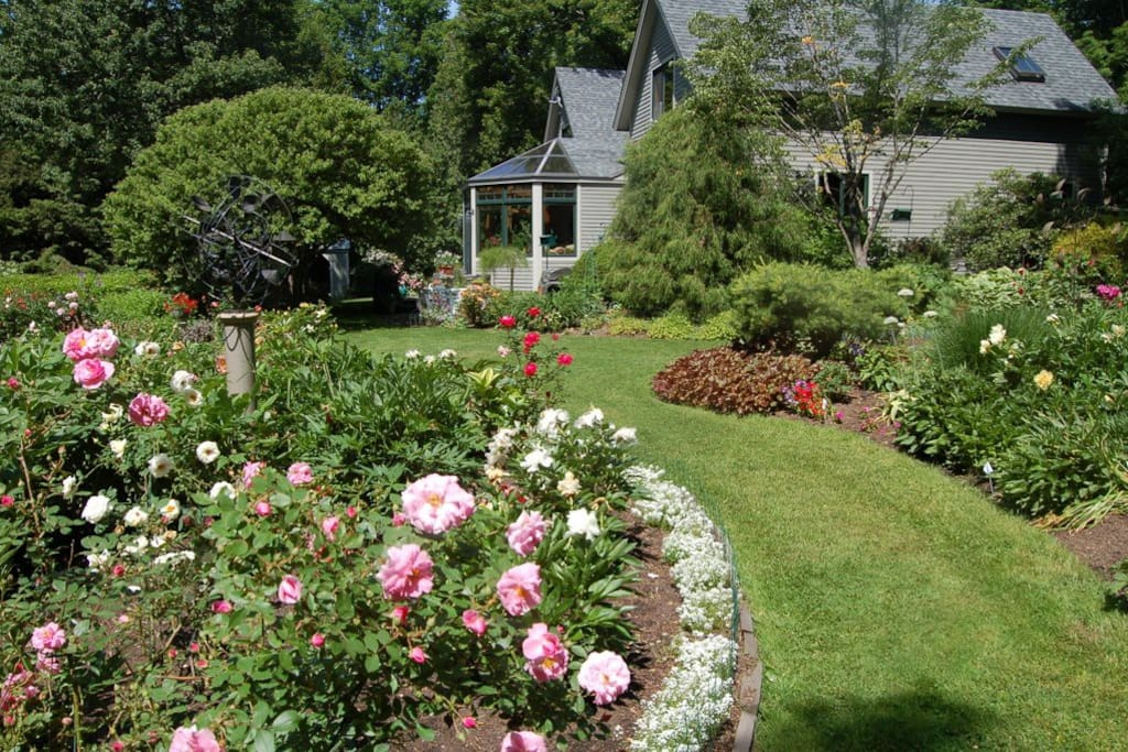 View of home and gardens from driveway.