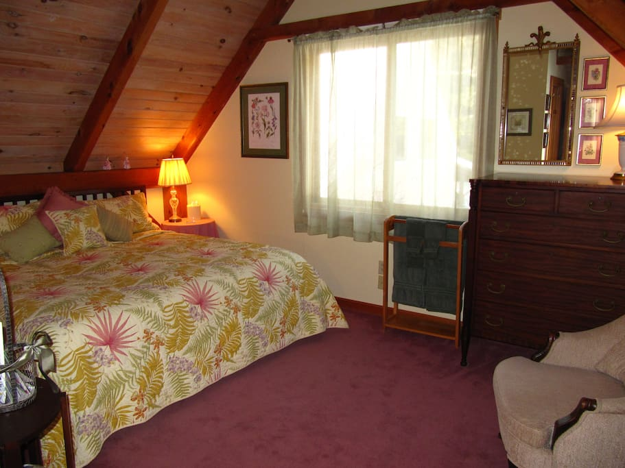 The Woods View Room with king bed (or two twins) and shared bath is the subject of this listing. Hearty breakfast included.