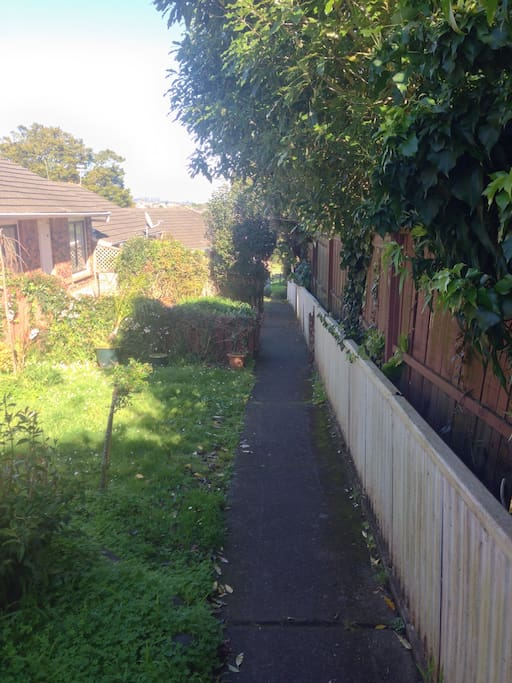 Our house is the last in a row of houses. This is the garden path that leads past the other houses to ours. After our house is the start of the horse paddocks and bush. This means the house is a very long way from any roads which makes it very quiet and peaceful