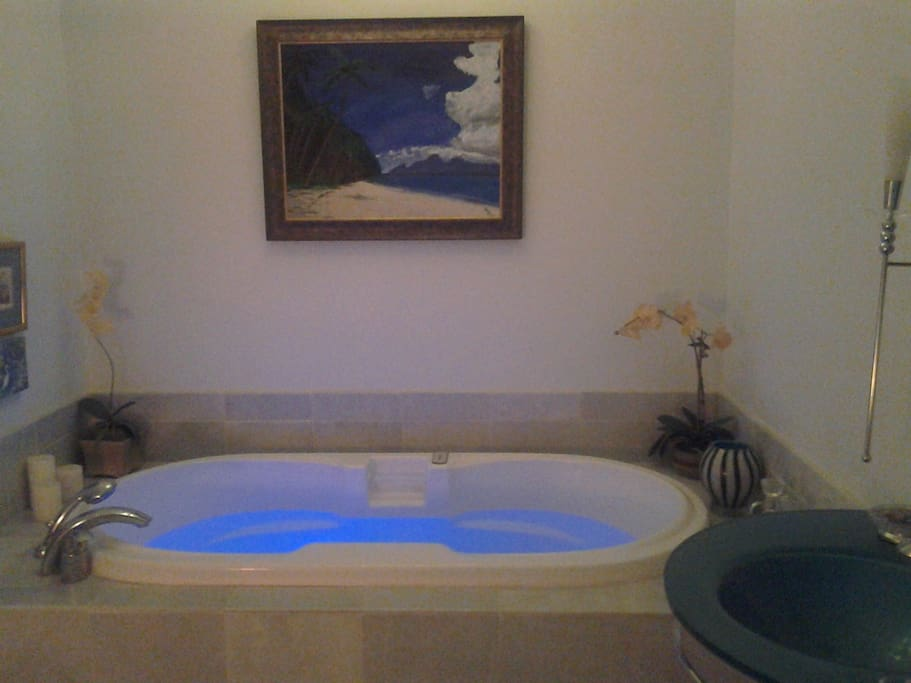 The tub for two with the blue lights on. Peony Suite
