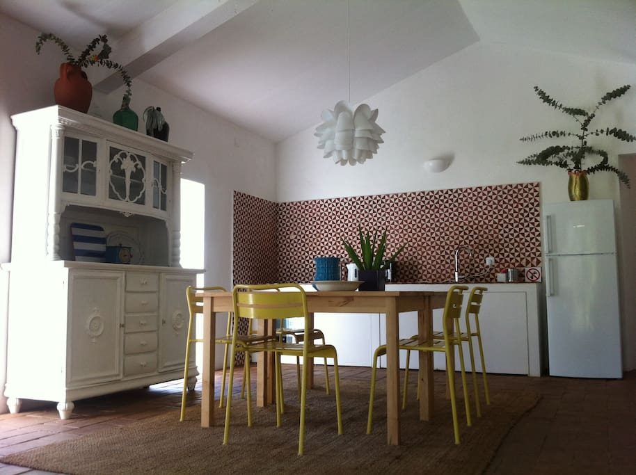 The kitchen/ living room with dining table