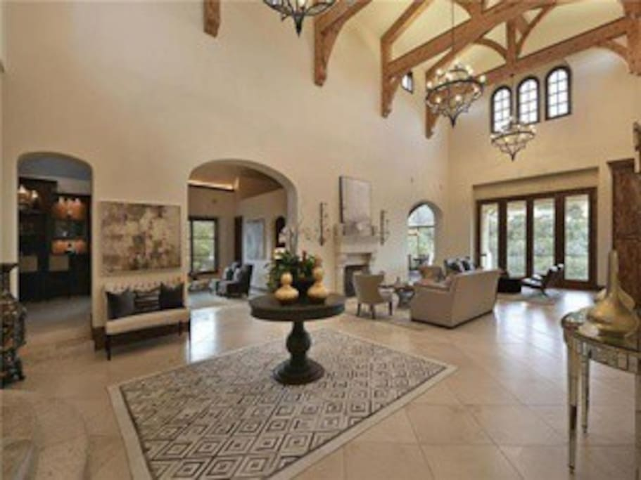 Great room with vaulted ceiling, beams