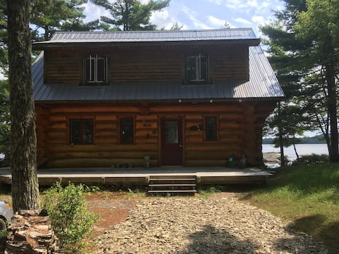 Remote off-the-grid, dreamlike lakefront log home