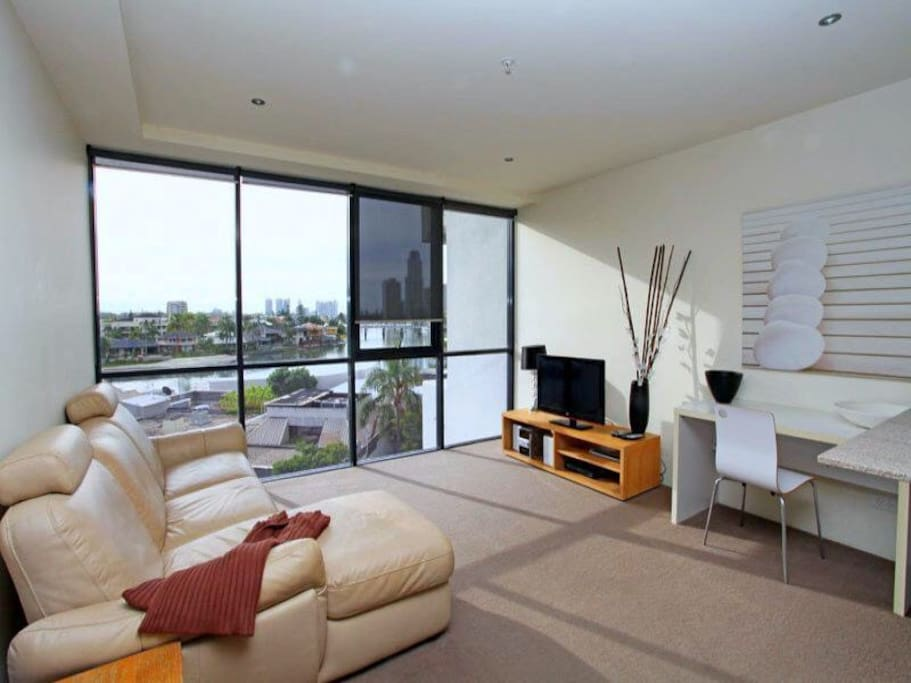 Main lounge area with leather recliner chair, books, videos, free wifi and FOXTEL