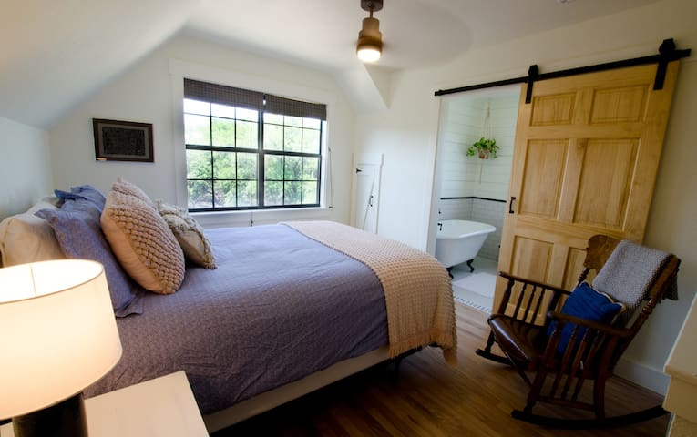 The upstairs loft master suite features a lovely view across the Wimberley valley. It is a loft bedroom, but completely visually private from the living area.