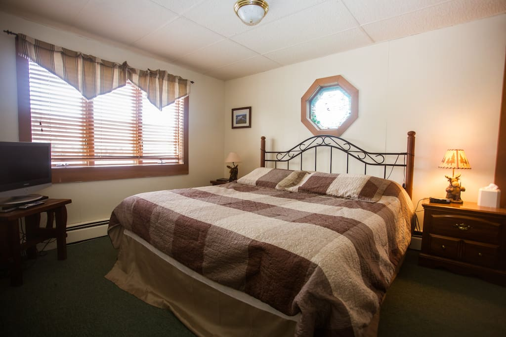 Our Adirondack Room, spectacular view of Big Moose Lake.  King Bed, Futon, TV, private bath.