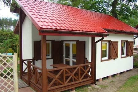 Comfy wooden cottage w/ covered furnished terrace and stone grill