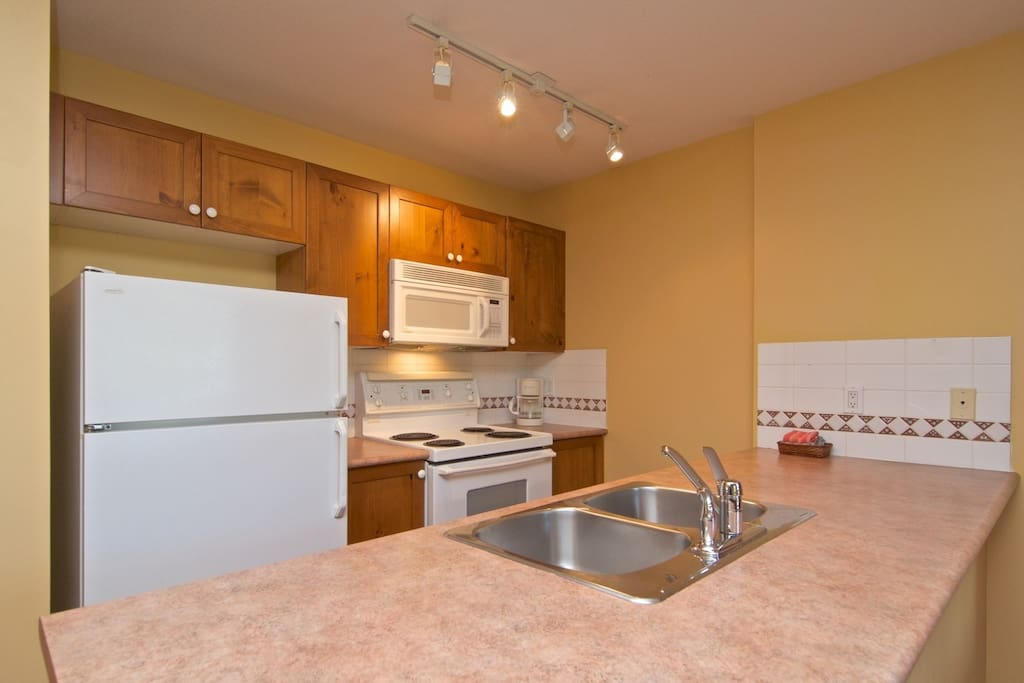 Comfortable kitchen with full sized appliances