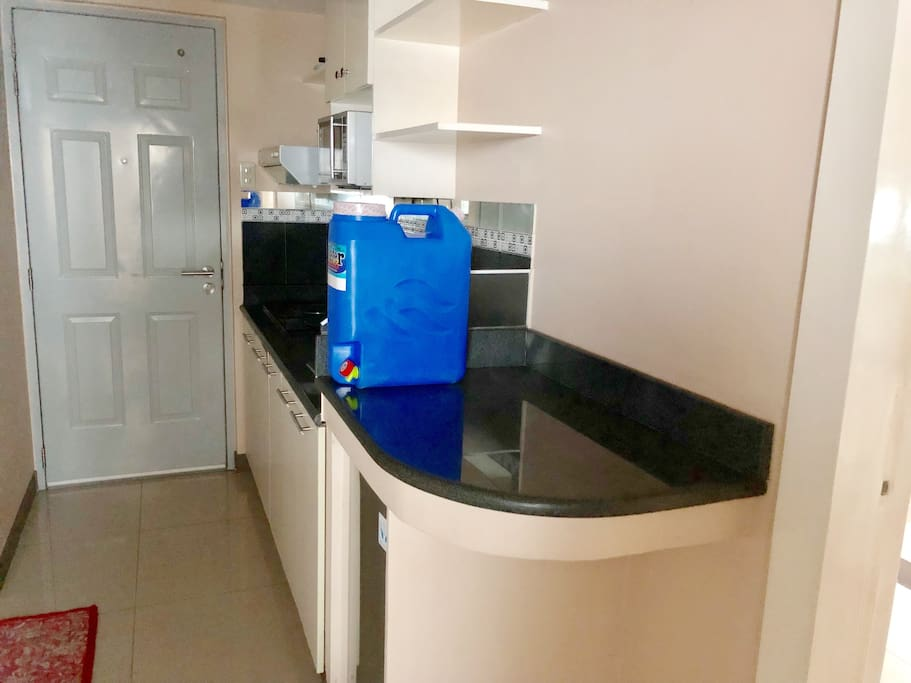Mini kitchen with your own mini bar, mini ref, sink, induction stove, microwave, and utensils