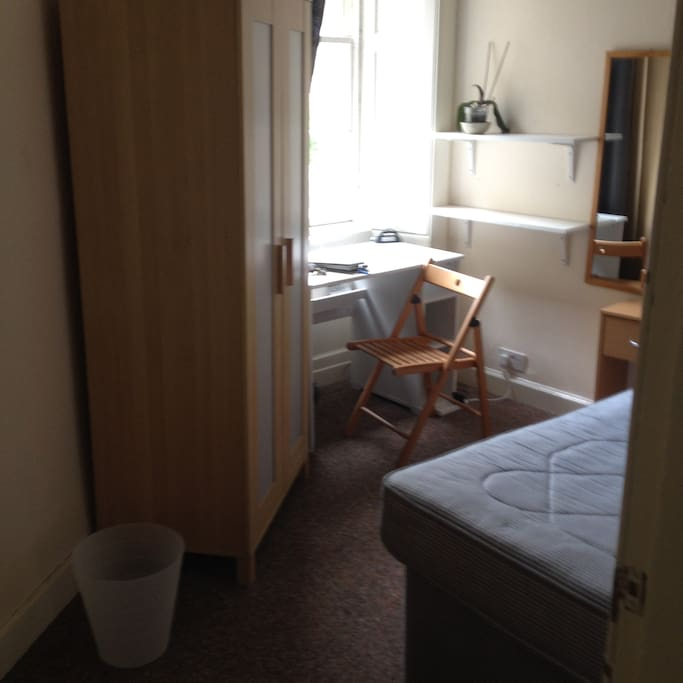 Each room has a double bed, wardrobe, desk or dressing table and mirror