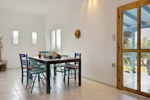 Enjoy your homemade meals inside or outside. Both tables a a few meters away from each other and from the kitchen