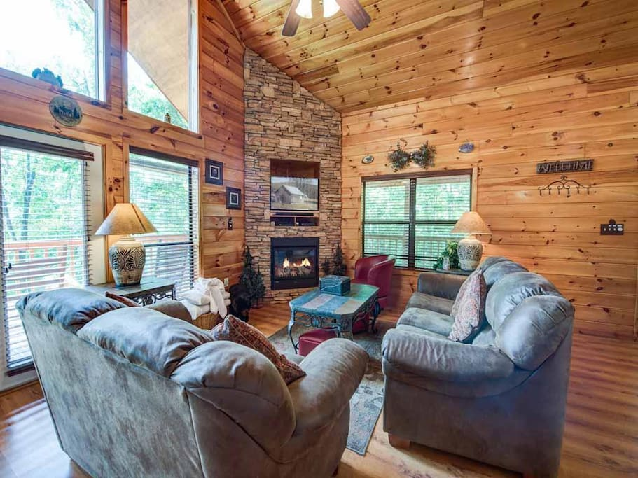 Gorgeous inside and out - Large picture windows bring the beauty of the surrounding woodlands into the great room, which boats wo