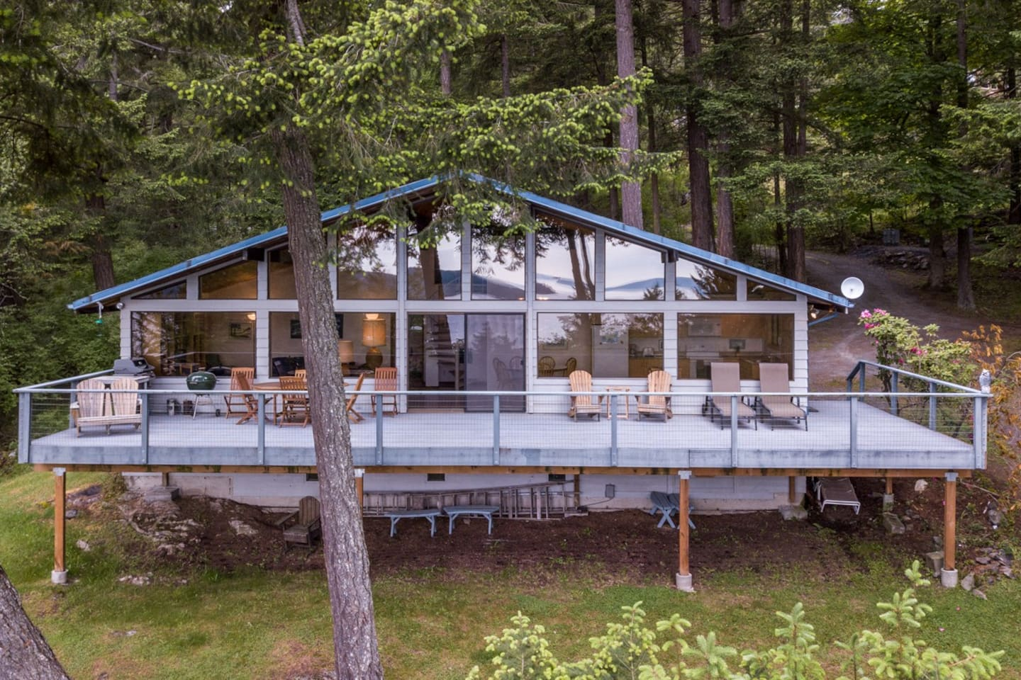 Cascade Bay Overlook is a warm and very comfortable cottage-home with an excellent view looking out over Cascade Bay and East Sound in the distance. Look closely and you can see the view reflected in the home's windows.
