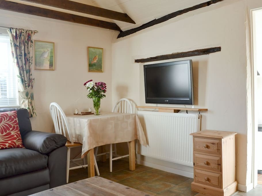 The lounge also has a small table for dining. TV with Freeview and DVD Player.