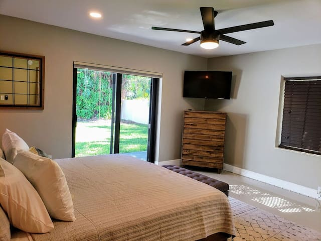 Spacious bedroom offers all needed amenities.
