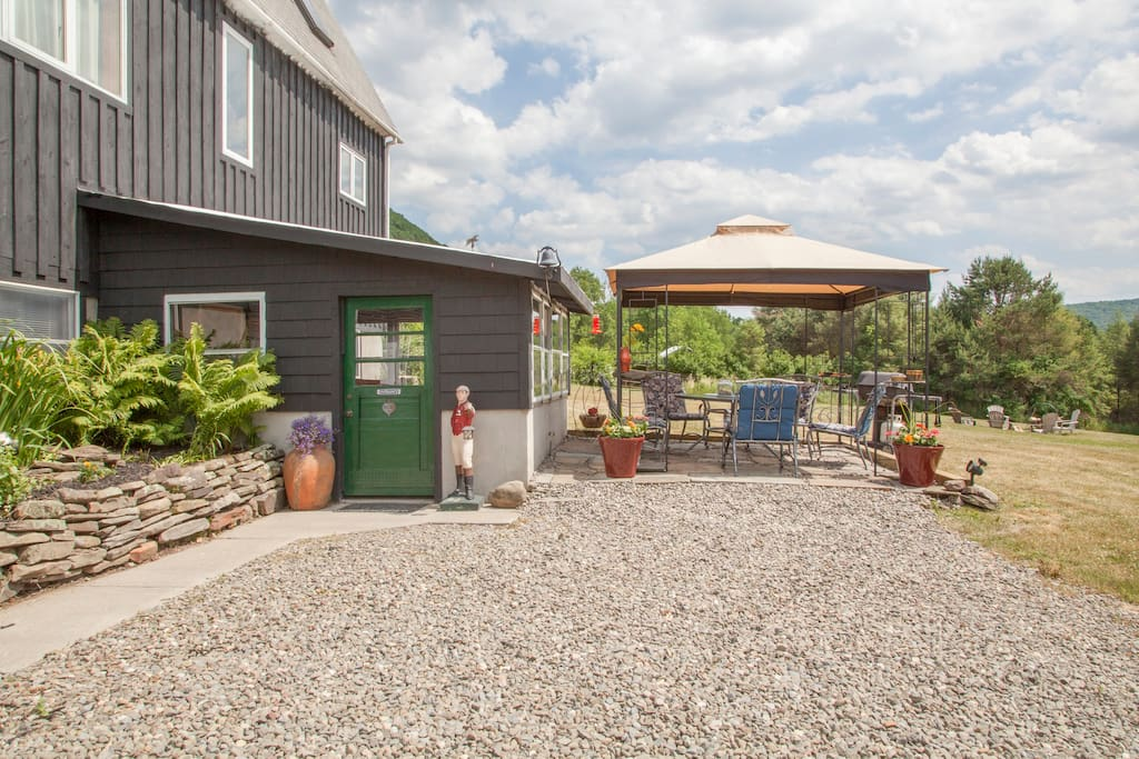 Off street parking and patio area with BBQ grill