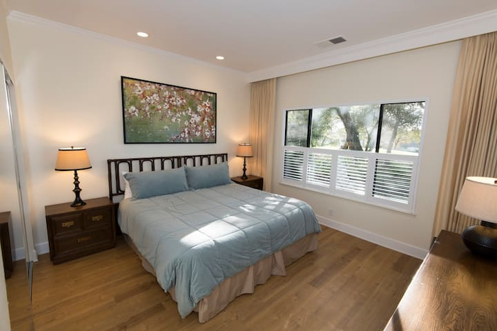 Master bedroom with King size bed and new hardwood floors.
