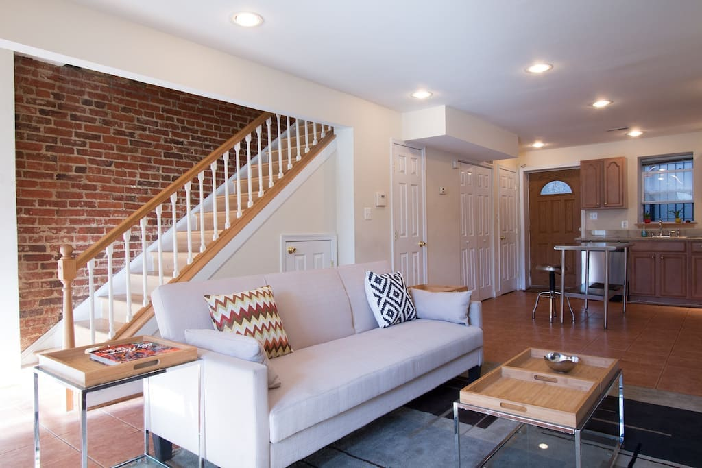 Main floor with exposed brick and full hardwood floor - Unit 2