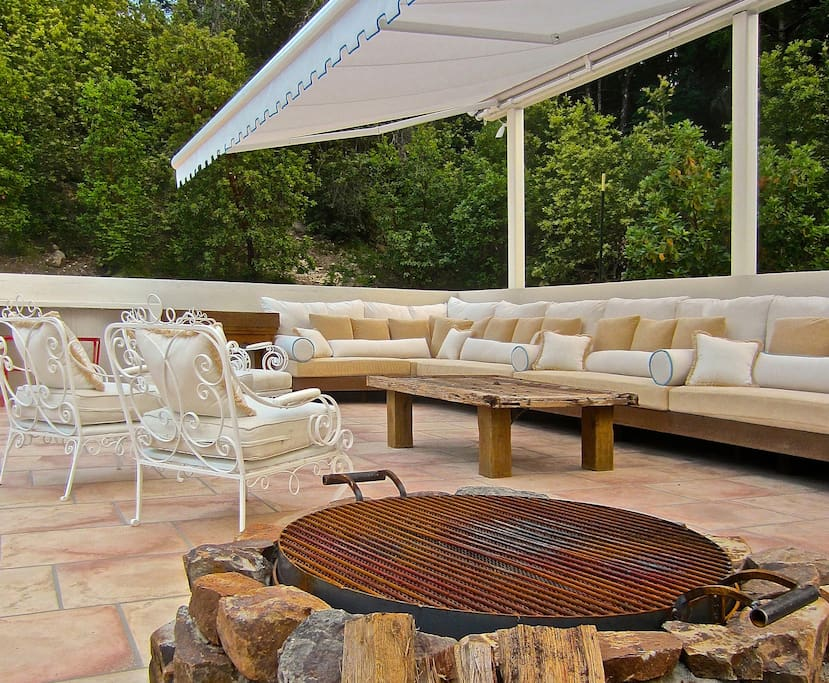 fire pit at edge of pool deck