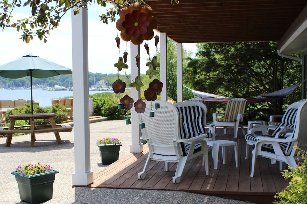 Covered deck offers a little reprieve from the sun for Happy Hour.